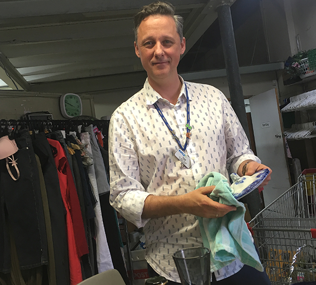 rspca op shop volunteer sorting store items
